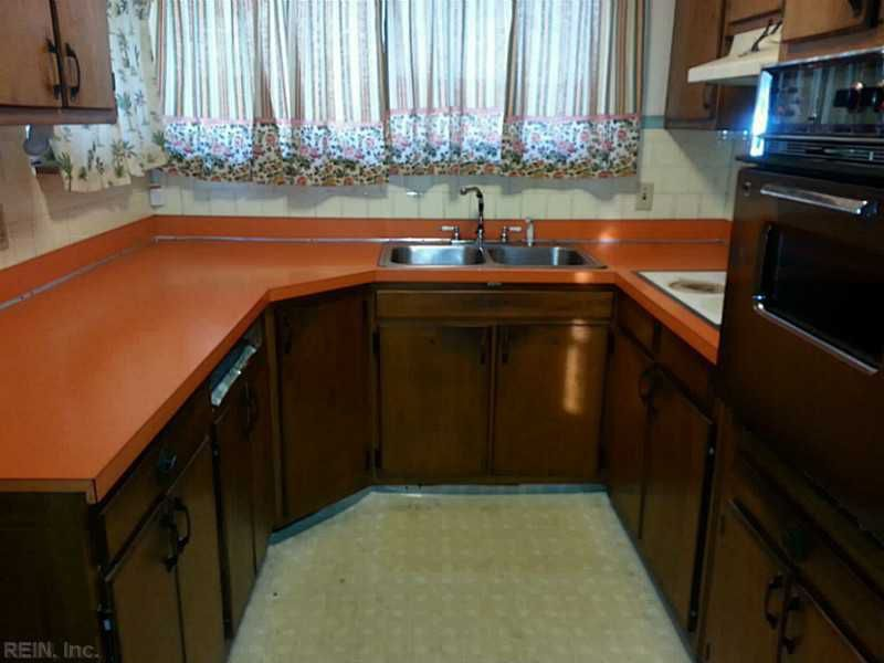 Traditional Kitchen with stone tile floors, Large Ceramic Tile, Wall Hood, Inset cabinets, Multiple Sinks, full backsplash