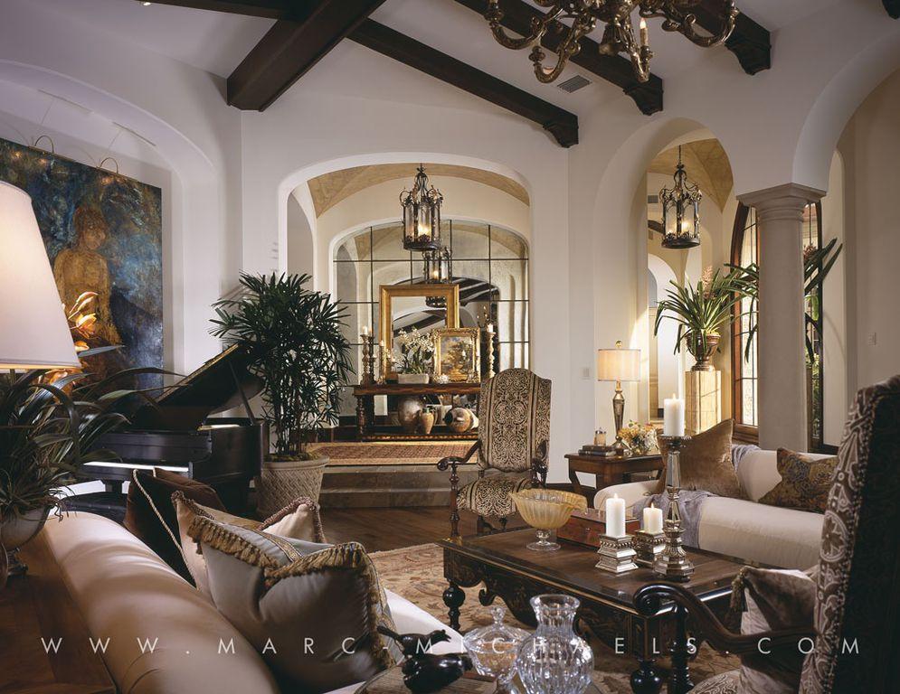 mediterranean living room with chandelier columns hardwood floors