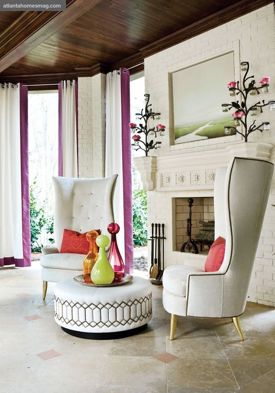 Eclectic Living Room with stone tile floors, TANGIER HASSOCK, Tom Dixon Wingback Chair, Crown molding, Exposed beam, Paint