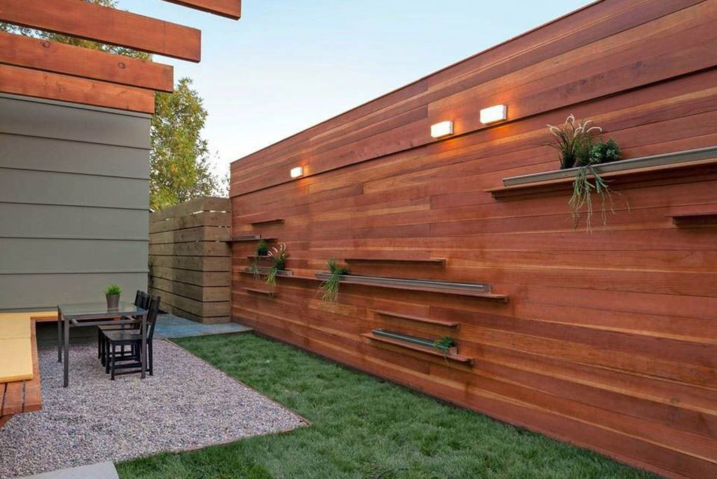 Contemporary Landscape/Yard with Fence, exterior stone floors, Trellis