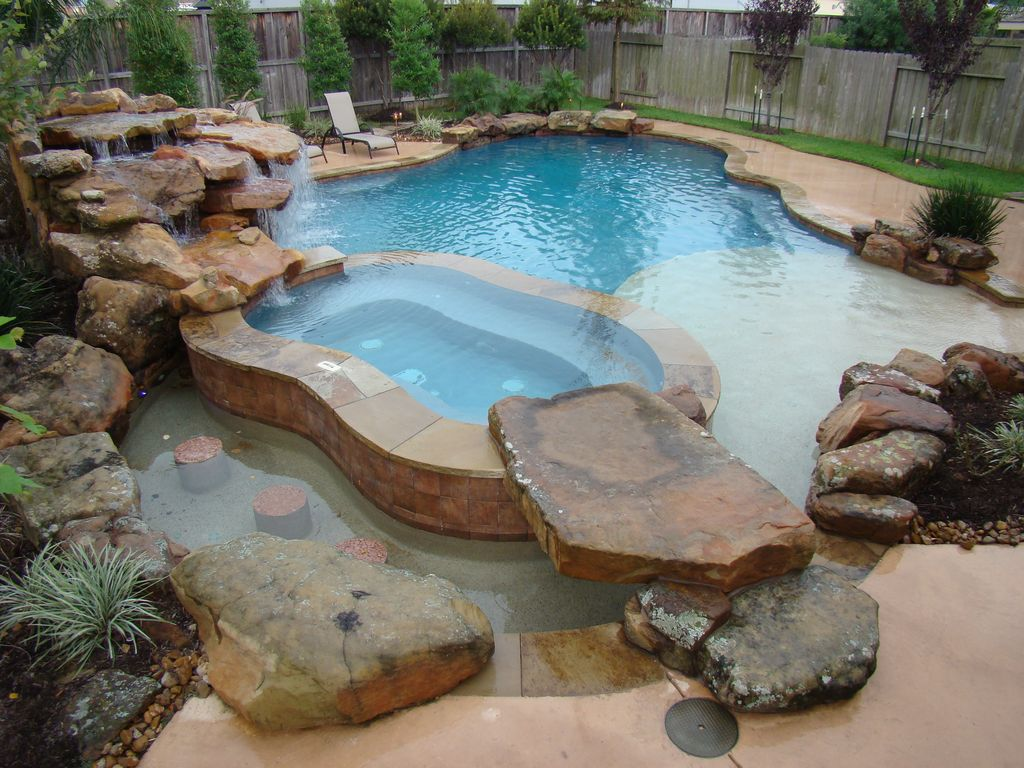 Rustic Swimming Pool With Water Feature By Signature Pools
