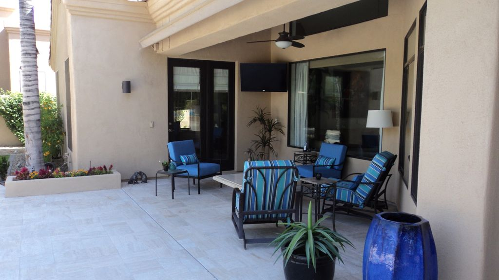 Patio with Fence, Pathway, picture window, French doors, exterior stone floors