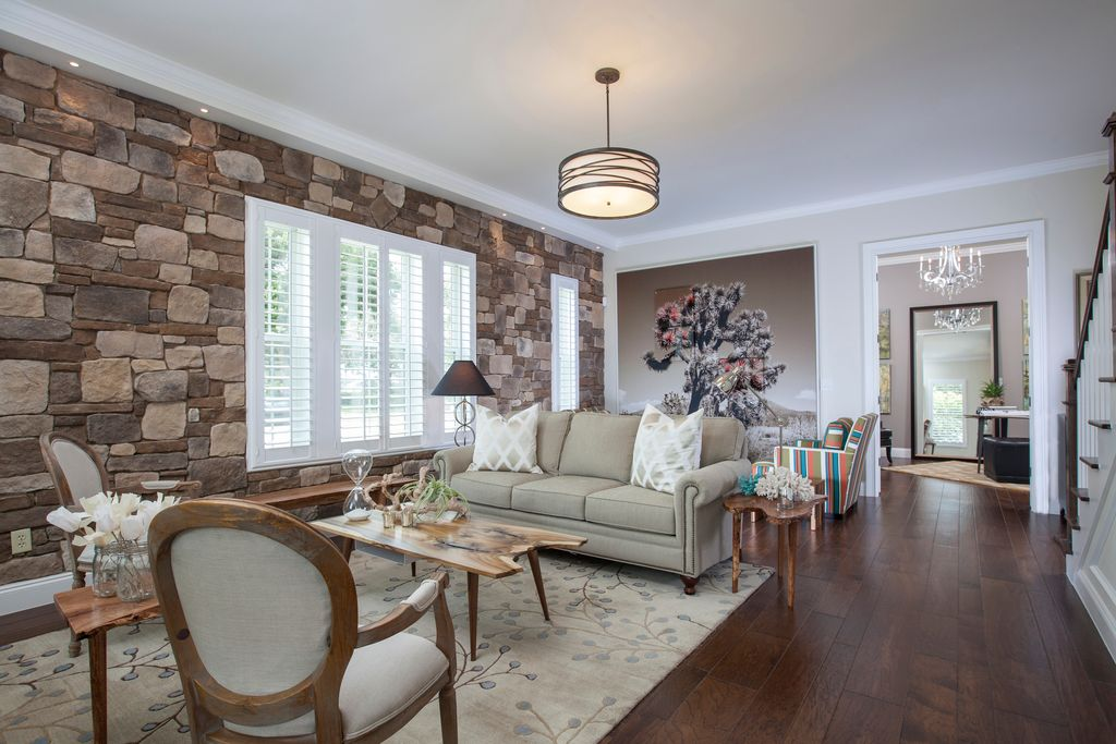 Eclectic Living Room with Pendant light, can lights, French doors, Crown molding, Standard height, Hardwood floors