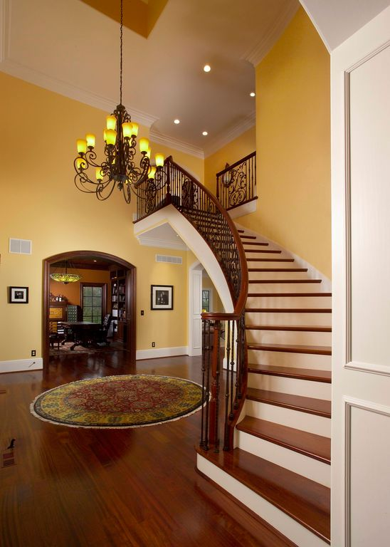 Traditional Staircase with curved staircase, specialty door, Cathedral ceiling, Crown molding, Laminate floors, Chandelier