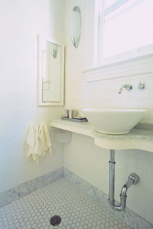 Traditional 3/4 Bathroom with Wall sconce, Wall Tiles, double-hung window, Vessel sink, penny tile floors, three quarter bath