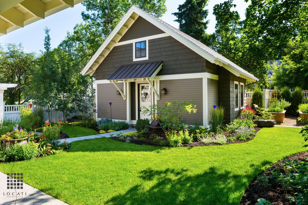 Traditional Landscape/Yard with Casement, exterior concrete tile floors, exterior tile floors, exterior awning, Trellis