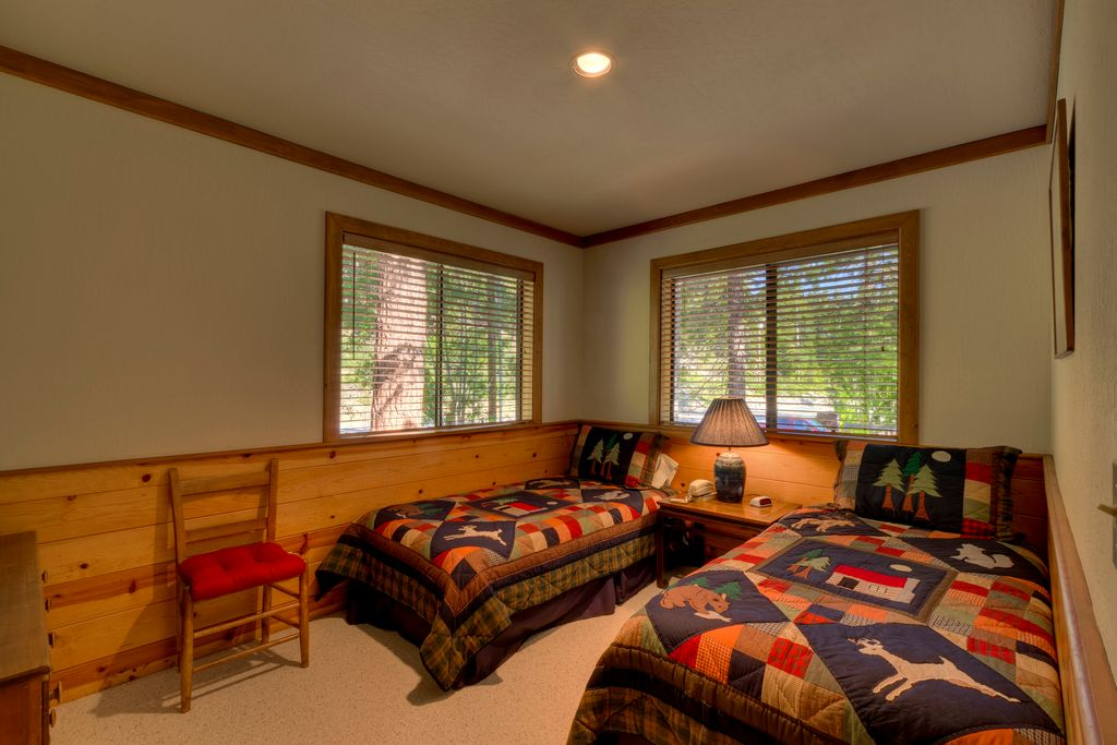 Rustic Guest Bedroom with Crown molding, Chair rail, Casement, can lights, Standard height, Carpet