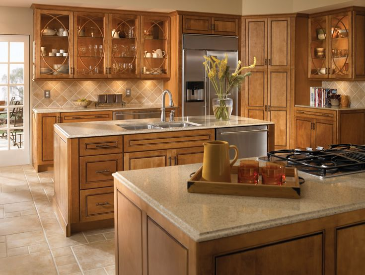 Craftsman Kitchen with Kitchen island, full backsplash, Simple granite counters, Built In Refrigerator, Glass panel, L-shaped