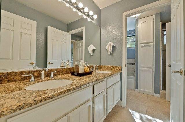 Cottage Master Bathroom with Wall Tiles, Standard height, full backsplash, framed showerdoor, Built-in bookshelf, Shower