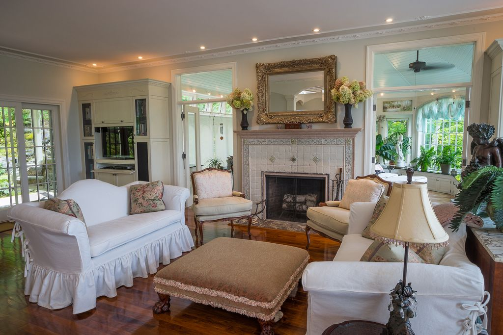 Traditional Living Room with can lights, French doors, picture window, stone fireplace, Transom window, Fireplace