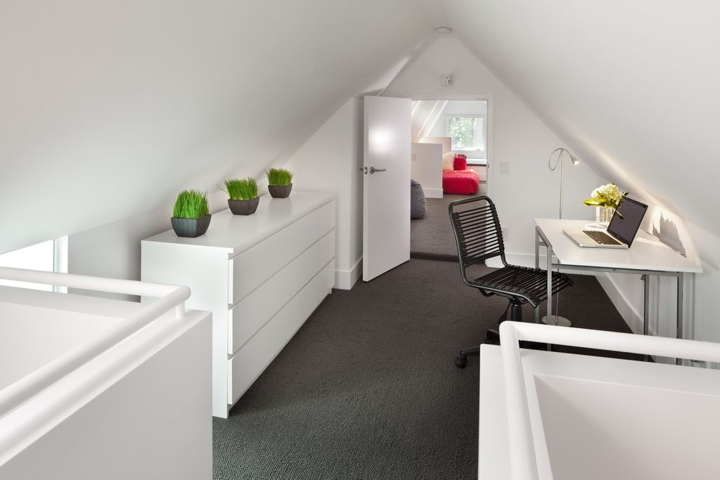 Contemporary Attic with Cathedral ceiling, flat door, Carpet, can lights, Built-in bookshelf