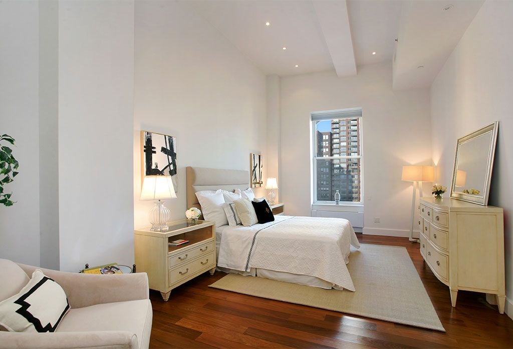 Contemporary Master Bedroom with double-hung window, Standard height, Exposed beam, Hardwood floors, can lights