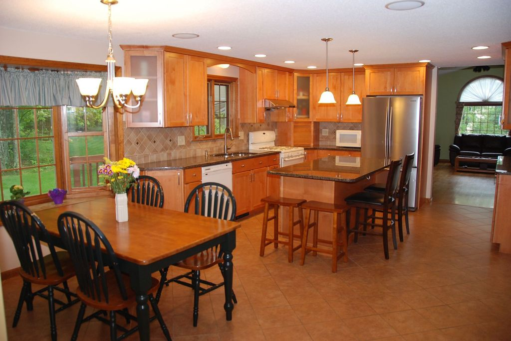 Country Kitchen with Paint, Kitchen island, Stone Tile, Breakfast bar, Flush, Flat panel cabinets, U-shaped, flush light