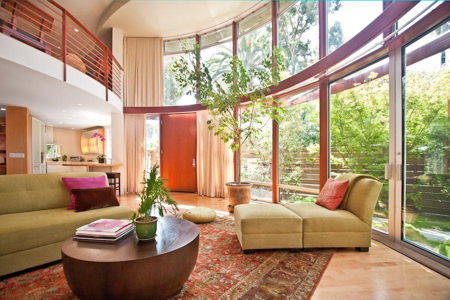 Modern Living Room with High ceiling, French doors, Hardwood floors, picture window, Transom window, flat door, Loft