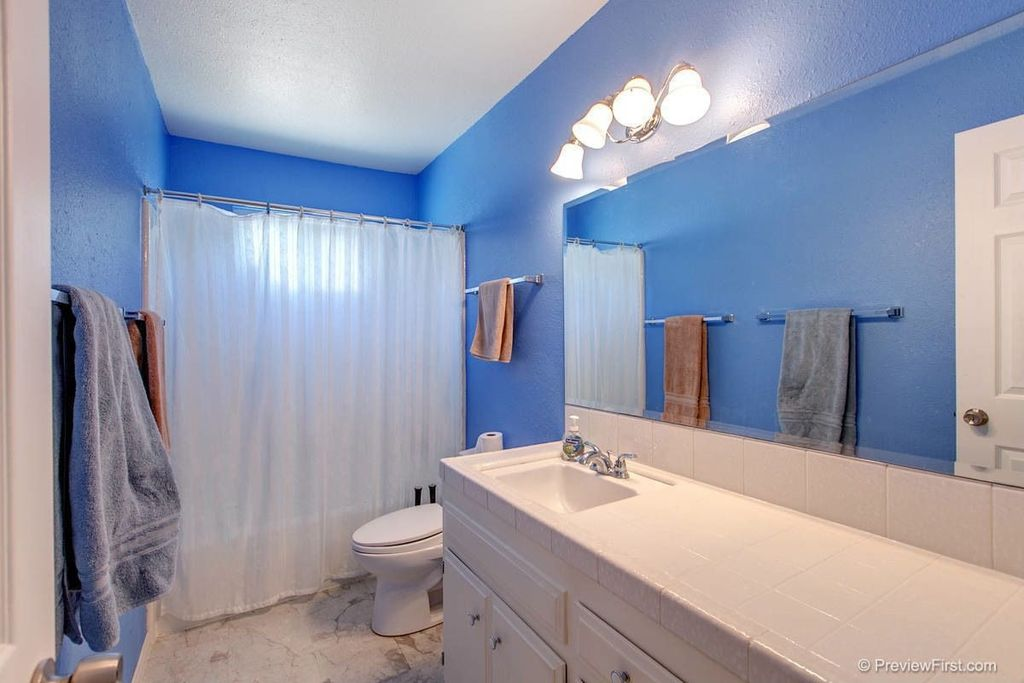 Traditional Full Bathroom with Undermount sink, complex marble tile floors, Inset cabinets, Large Ceramic Tile, Raised panel