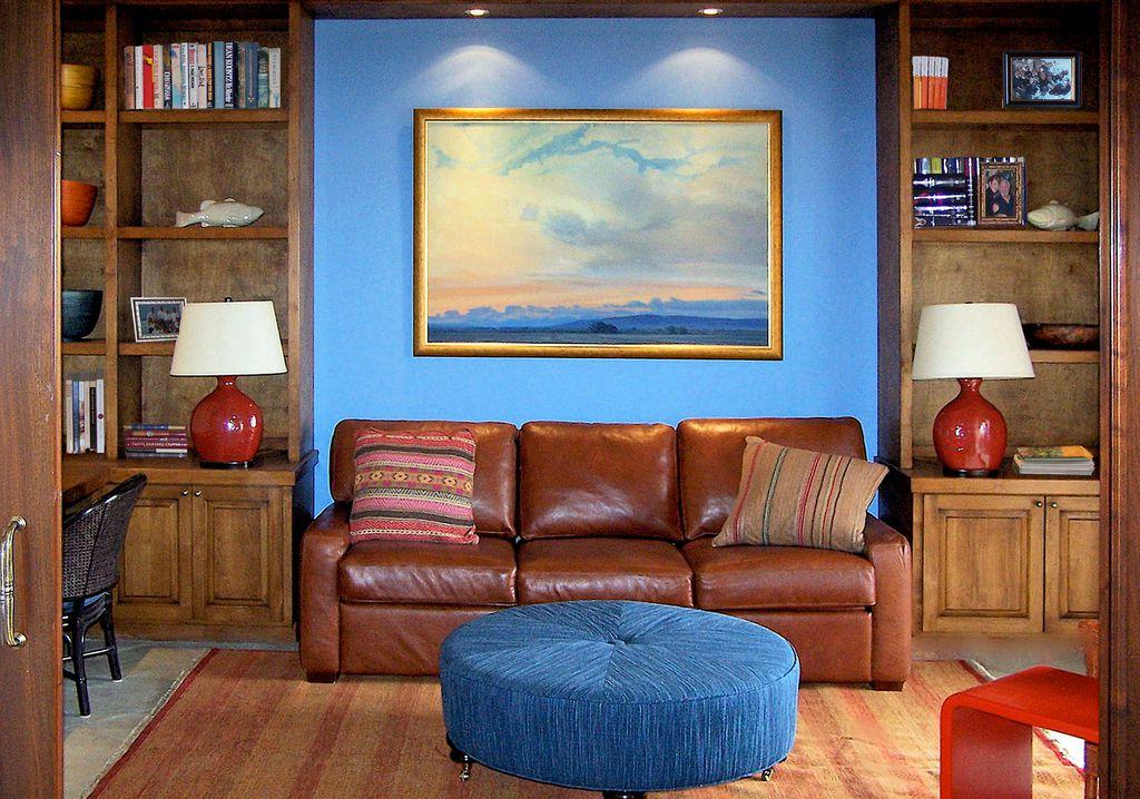 Eclectic Home Office with can lights, Built-in bookshelf, Standard height, Concrete floors, specialty door