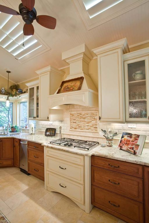 Country Kitchen with Undermount sink, Standard height, Subway Tile, stone tile floors, Raised panel, Ceiling fan, Wall Hood