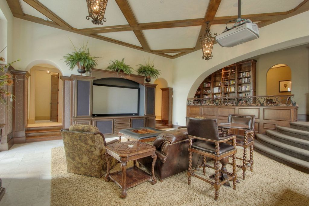 Traditional Game Room with Wainscotting, Built-in bookshelf, limestone floors, Exposed beam, Crown molding, Standard height