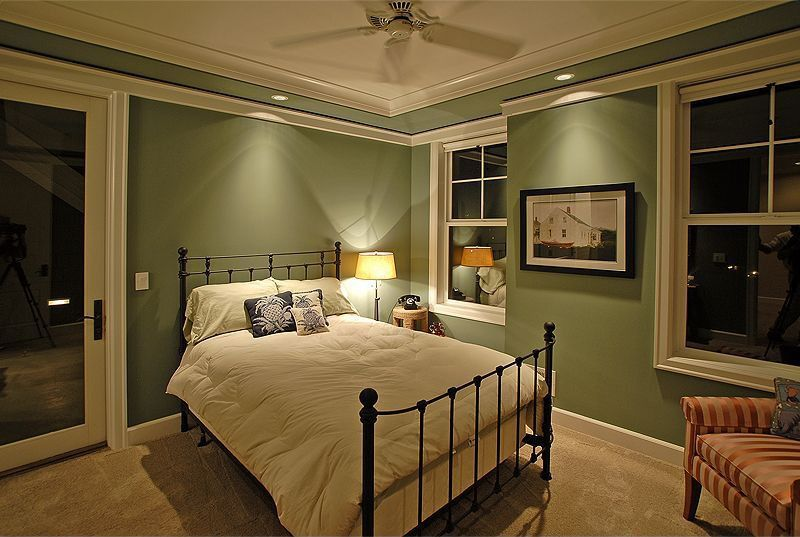 Traditional Guest Bedroom with Carpet, Ceiling fan, Crown molding, can lights, double-hung window, French doors