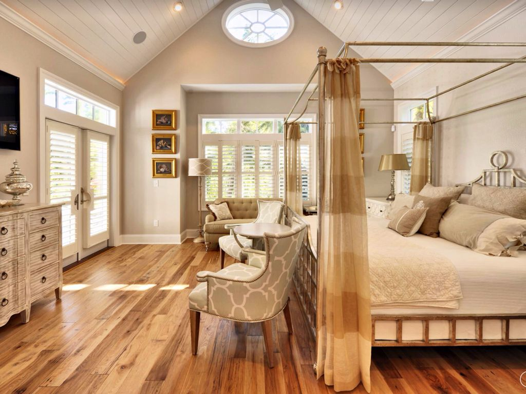 Cottage Master Bedroom with Plantation shutters, can lights, Crown molding, Shiplap ceiling, Transom window, High ceiling