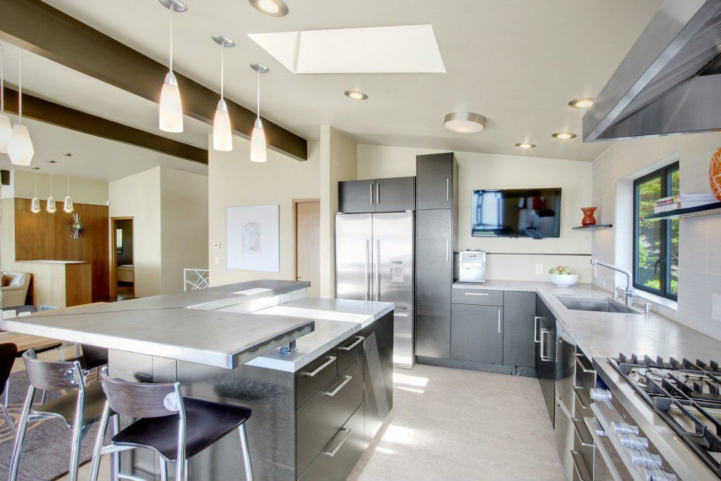 Contemporary Kitchen with Travertine Tile, L-shaped, Flush, Kitchen island, Stone Tile, Breakfast bar, Slate counters