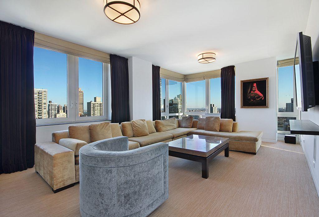 Contemporary Living Room with flush light, Standard height, Casement, Concrete floors