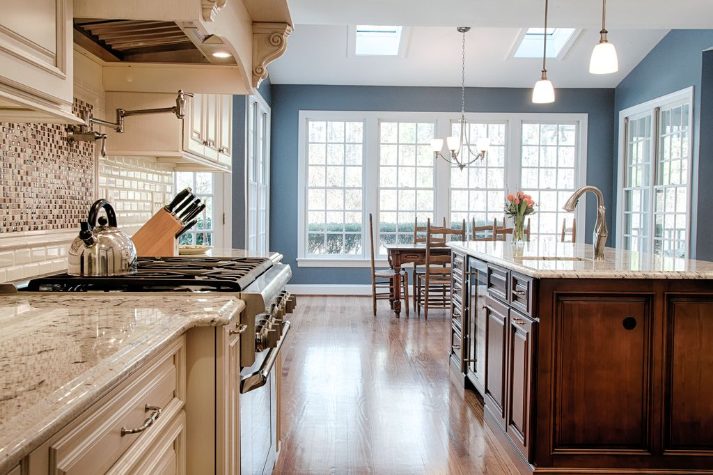 Traditional Kitchen with Standard height, French doors, Framed Partial Panel, Wine refrigerator, Ceramic Tile, can lights