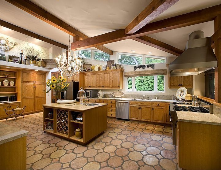 Rustic Kitchen with Flush, can lights, High ceiling, Built In Refrigerator, partial backsplash, Chandelier, Multiple Sinks