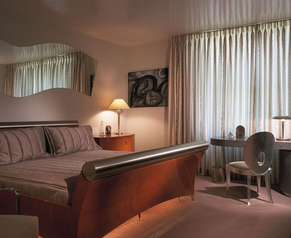 Modern Guest Bedroom with Standard height, specialty window, Concrete floors
