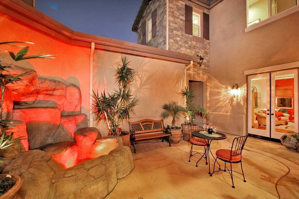 Mediterranean Patio with French doors, Fence, exterior tile floors, picture window, exterior concrete tile floors