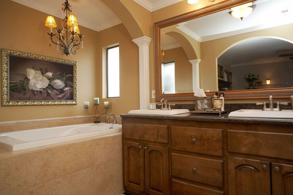 Mediterranean Full Bathroom with Double sink, Crown molding, drop-in sink, Columns, Bathtub, Framed Partial Panel