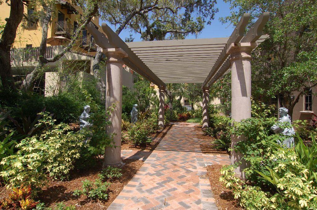 Mediterranean Landscape/Yard with exterior herringbone tile floors, Pathway, exterior tile floors, Trellis