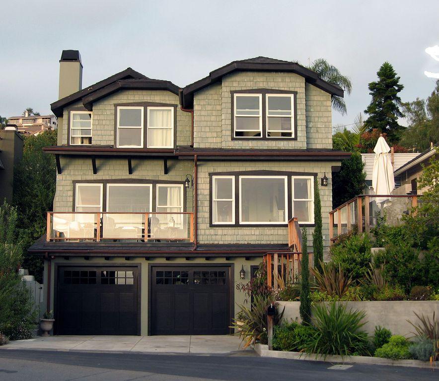 Craftsman Garage with Gate, Casement, six panel door, exterior stone floors, Transom window, Deck Railing, Raised beds