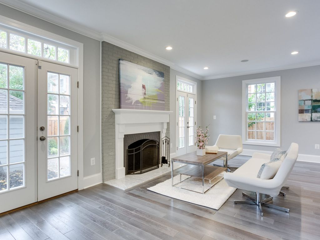 Living Room with Cement fireplace & Hardwood floors in ...