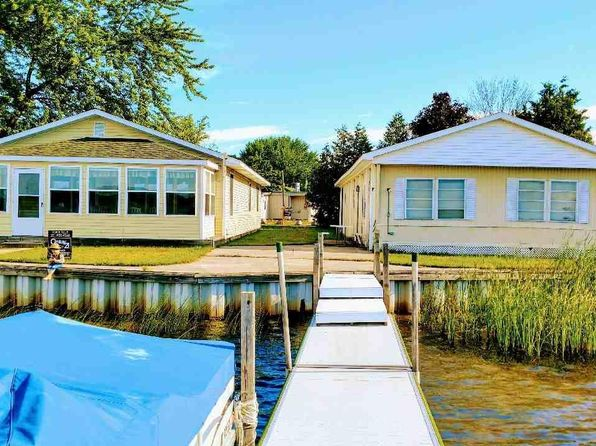 5 bed 4 bath Single Family at 4977 Dock St Onekama, MI, 49675 is for sale at 379k - 1 of 56